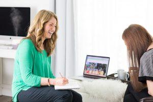 two mature women happy, talking